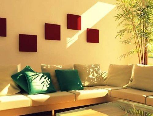 Habitación decorada con estilo feng shui y sala de color blanco con cojines verdes